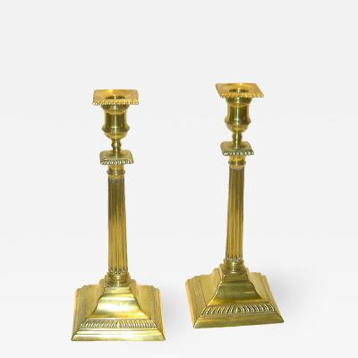 Pair of tall Chippendale brass candlesticks