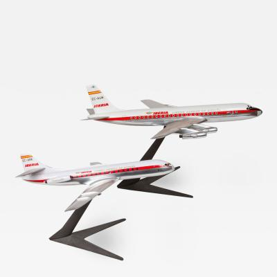 Pair of unmatched if solid aluminium Iberia Airplane models