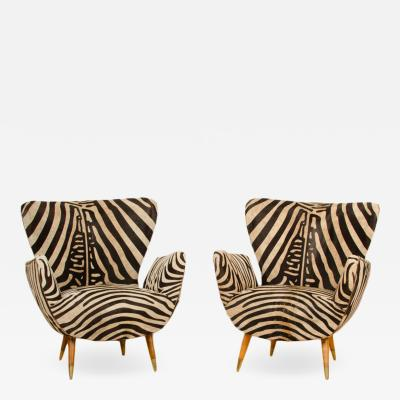 Paolo Buffa A pair of wingback chairs by Paolo Buffa recently upholstered with zebra print