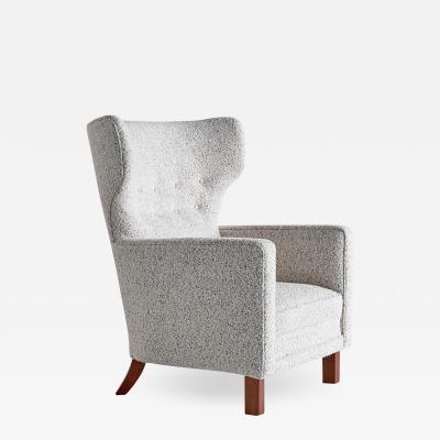Paul Boman Paul Boman Wingback Chair in Pearl Boucl Fabric and Beech Finland 1940s