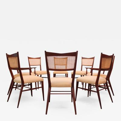 Paul McCobb Set of Eight Stained Mahogany and Cane Directional Dining Chairs by Paul McCobb