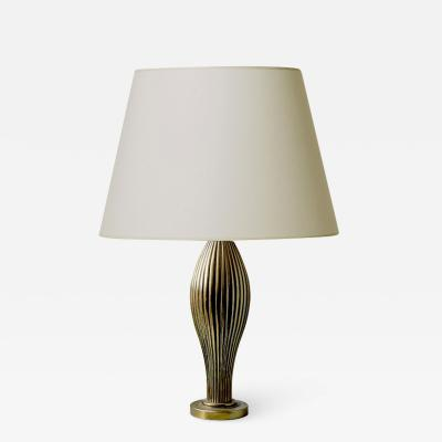 Per Sk ld Evocative reeded biomorphic lamp in brass by Per Sk ld