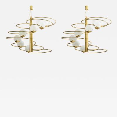 Pia Guidetti Crippa A Pair of Mid Century Modern chandeliers by Pia Guidetti Crippa for Lumi