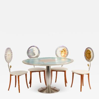 Piero Fornasetti A set of four chairs and table in the Fornasetti style circa 1985