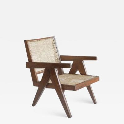 Pierre Jeanneret Easy Chair 1955 with an incurved back attached to the seat