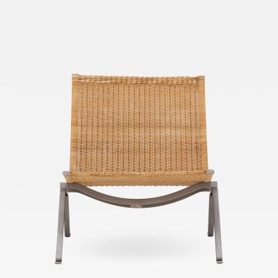 Poul Kj rholm Easy chair in wicker