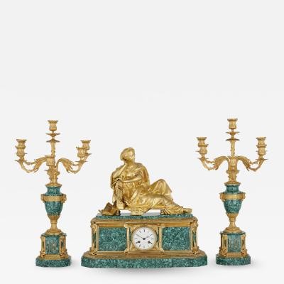 Raingo Fr res French gilt bronze mounted malachite three piece clock set by Raingo Fr res