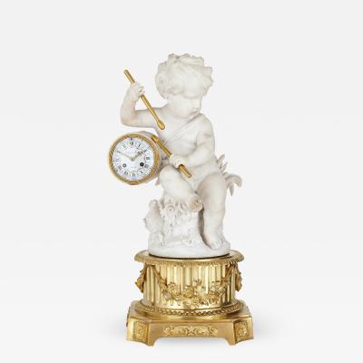 Raingo Fr res Gilt bronze and marble cherub mantel clock by Raingo Fr res