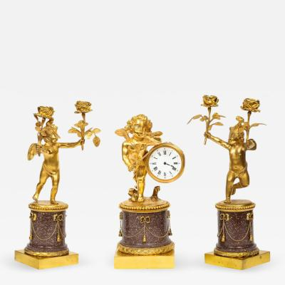 Rare French Gilt Bronze Ormolu and Porphyry Three Piece Clock Set circa 1880