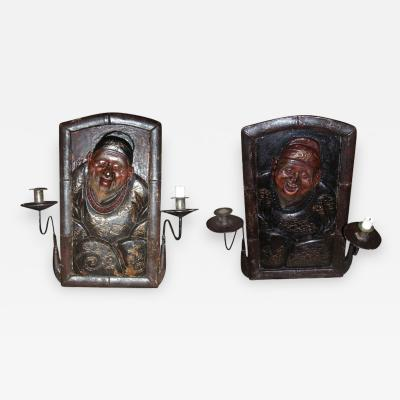 Rare pair of 19th century sconces with Chinese personages