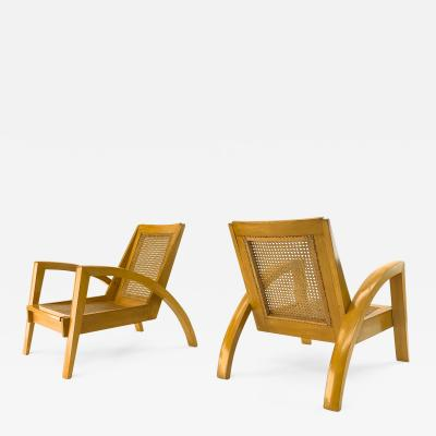 Riviera style pair of blond canned lounge chairs