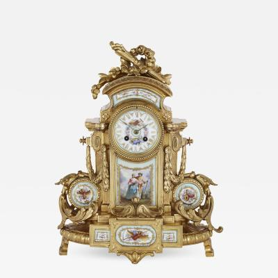 Rococo style gilt bronze mantel clock with S vres style porcelain plaques