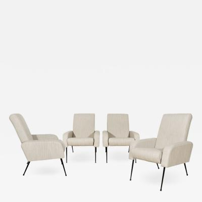 SET OF FOUR AIRBORNE STYLE ARMCHAIRS