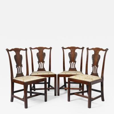 SET OF FOUR GEORGE III CARVED SIDE CHAIRS