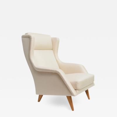 SLEEK SCANDINAVIAN wingback LOUNGE CHAIR WITH SPLAYED LEGS