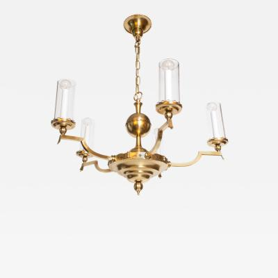 SWEDISH ART DECO FIVE ARM BRASS CHANDELIER WITH CYLINDRICAL GLASS SHADES