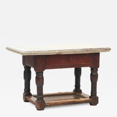 SWEDISH BAROQUE TABLE WITH LAND LIMESTONE TOP