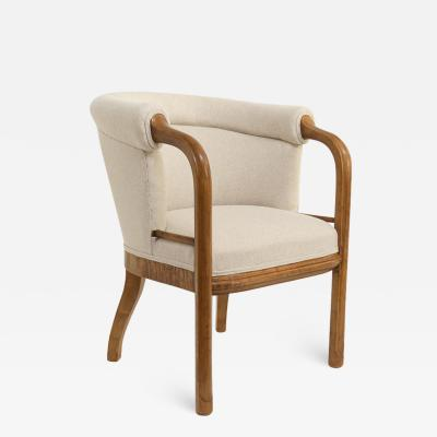 Scandinavian Modern Art Deco armchair in solid stained birch with carved frame