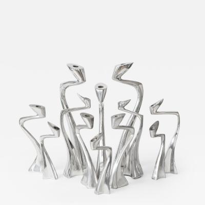 Set of 12 aluminum candlesticks