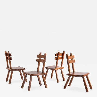 Set of Four Handcrafted Brutalist Dining Chairs in Solid Oak France 1960s