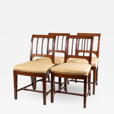 Set of four George III cane seat mahogany side chairs