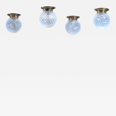 Set of four glass and brass ceiling lamps