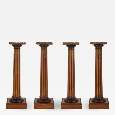 Set of four wood marble and gilt bronze columns