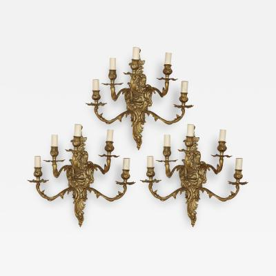 Set of three gilt bronze sconces in the Baroque style