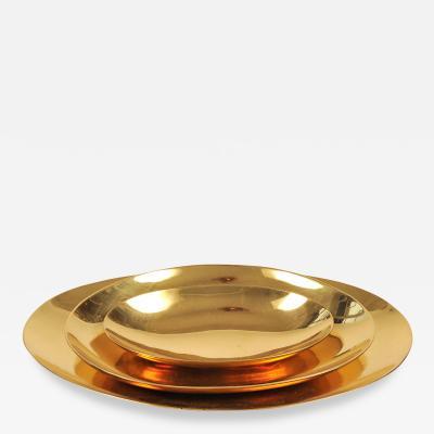 Set of three handmade cast brass trays