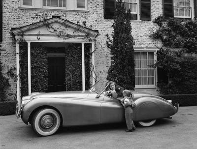 Sid Avery Humphrey Bogart Lauren Bacall and their son Stephen in their Jaguar XK 120