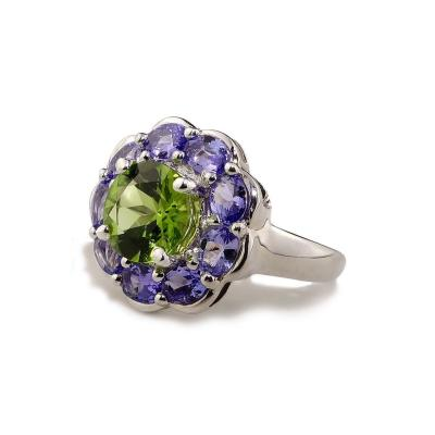 Sparkling Cocktail Ring of Green Peridot in Tanzanite Halo Sterling Silver