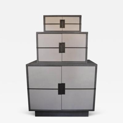 Stacked Grey and White cabinet with Brass