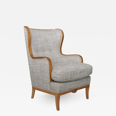 Swedish Grace Art Deco large wingback chair with carved stolid birch frame