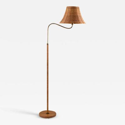 Swedish Modern Midcentury Floor Lamp in Brass and Rattan 1940s