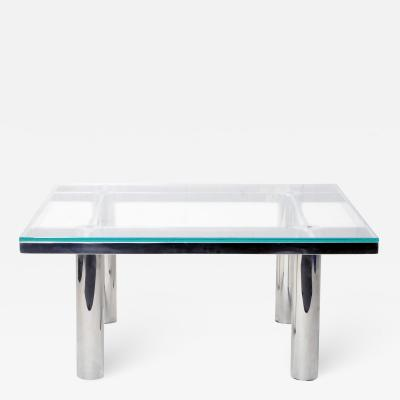 TABLE WITH VINTAGE CHROME LEGS AND NEW GLASS TOP