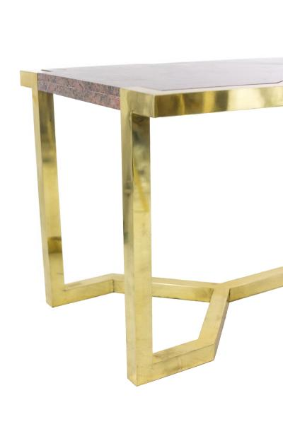 Table in gilt brass and pink granite Italy 1970s