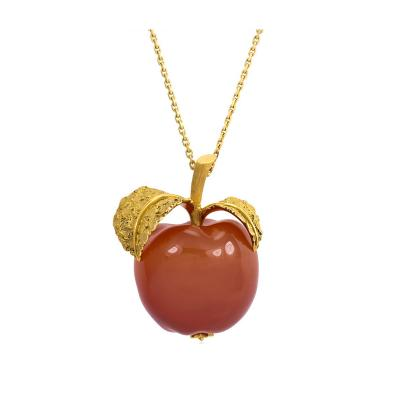 Textured Gold and Carved Carnelian Apple Pendant