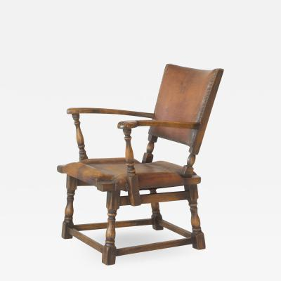 Theo Ruth LEATHER AND OAK ARMCHAIR