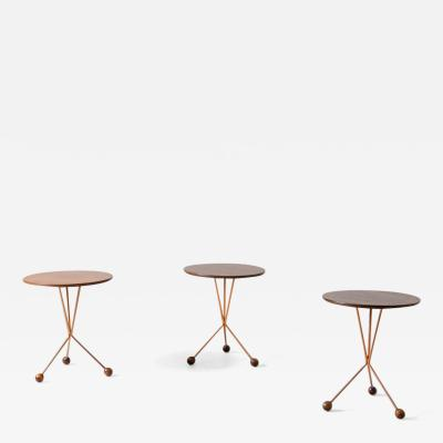 Three coffee tables with base in copper rod and wooden top