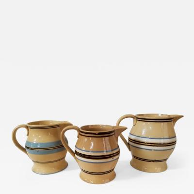 Three exceptional banded yellowware pitchers