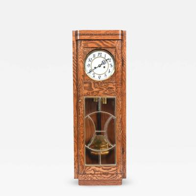 Tiger Oak Case Beveled Glass Trimmed Brass Wall Clock
