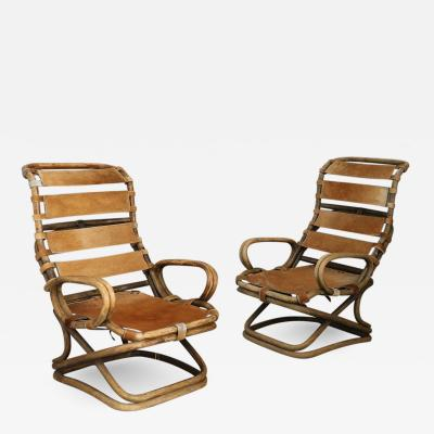 Tito Agnoli Pair of armchairs by Tito Agnoli for Bonacina in ratan and horse horse skin