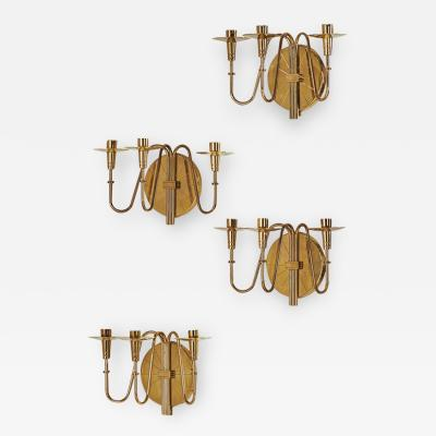 Tommi Parzinger Elegant set of 4 polished brass sconces by Tommi Parzinger