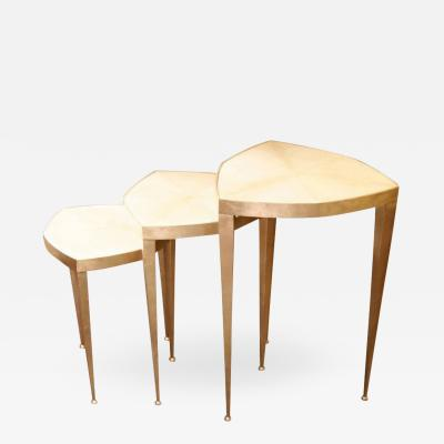 Trifolium set of three pedestal tables in gold leaf on steel and parchment