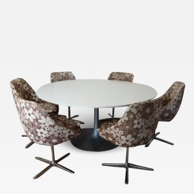 Tulip dining table with six egg swivel dining chairs