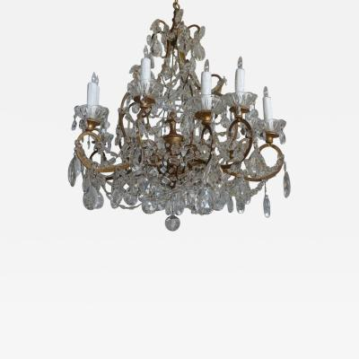 Twelve Light Italian Gilt Metal Crystal Chandelier