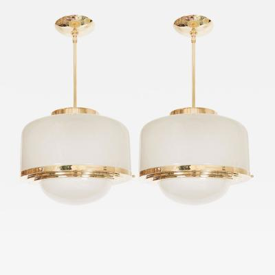 Two Brass Mid Century Pendant Fixtures with Patterned Glass Shades