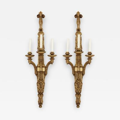 Two Louis XVI style carved giltwood wall sconces