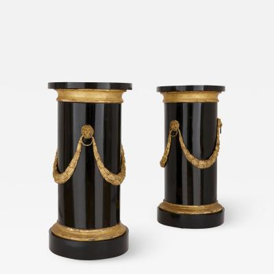 Two antique marble gilt and ebonised wood columnar pedestals