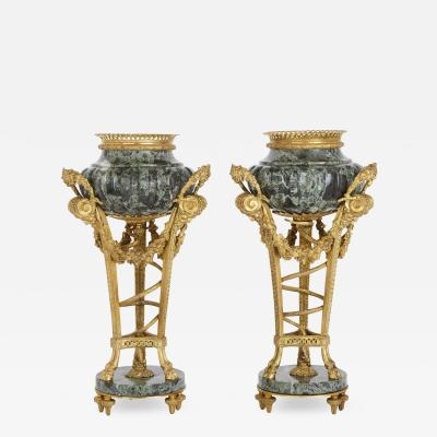 Two gilt bronze mounted Verde Antico marble urns after Gouthi re